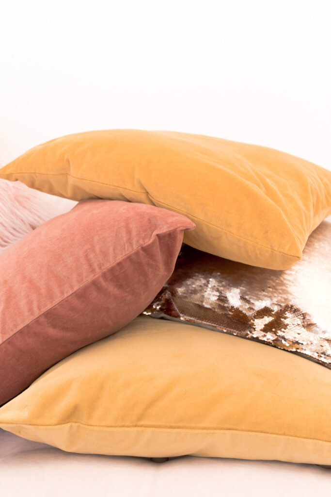 citrus color throw pillows stacked