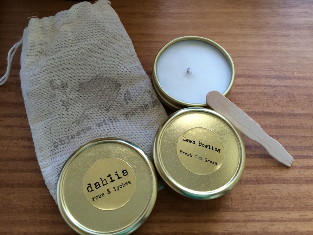 three tins with candle wax against burlap bag