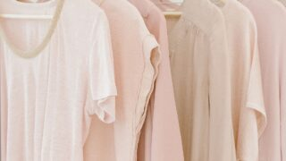 pink t-shirts hanging on a clothing rack