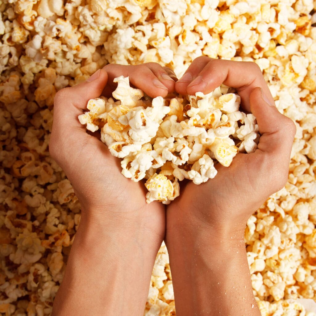 woman holding popcorn in her hands