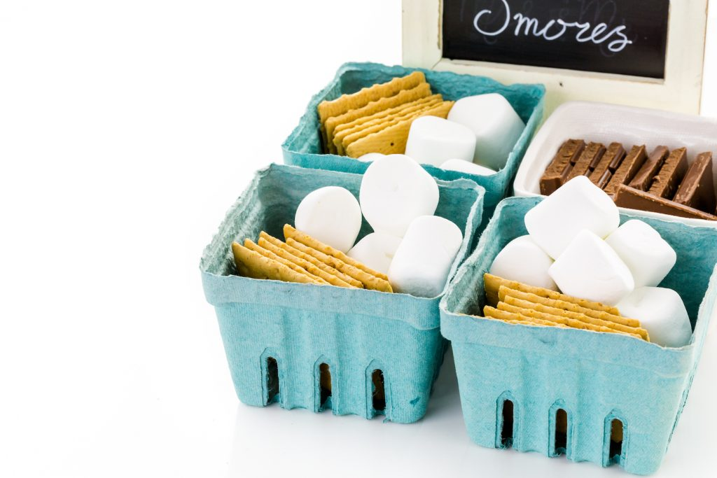 smores kit ingredients in baskets of marshmallows graham crackers and chocolate