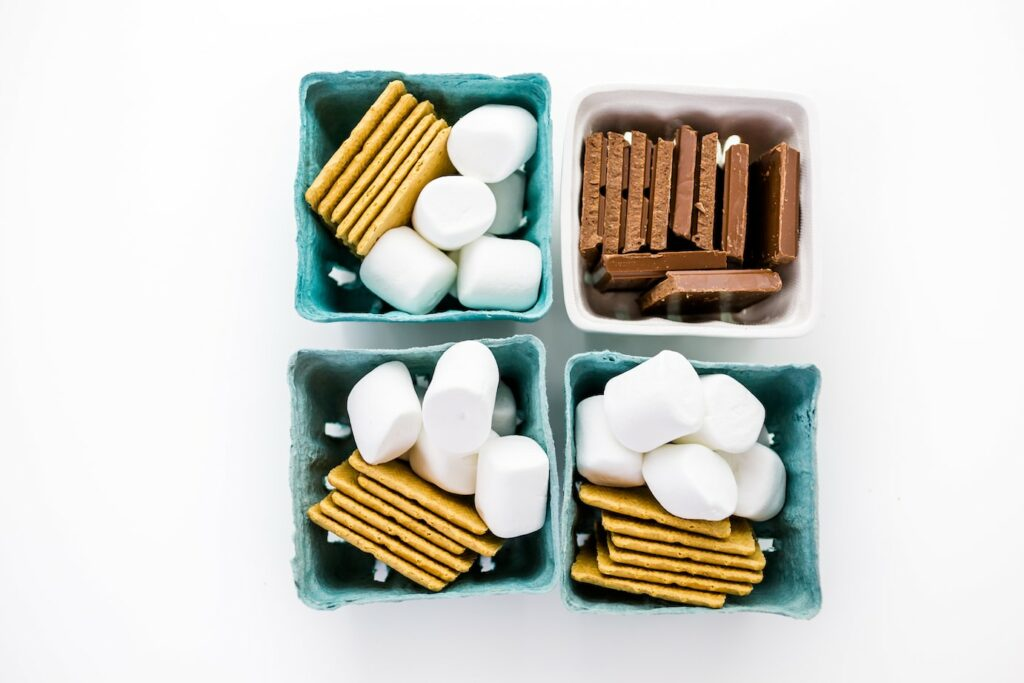 blue baskets filled with smores kit ingredients marshmallows graham crackers and chocolate