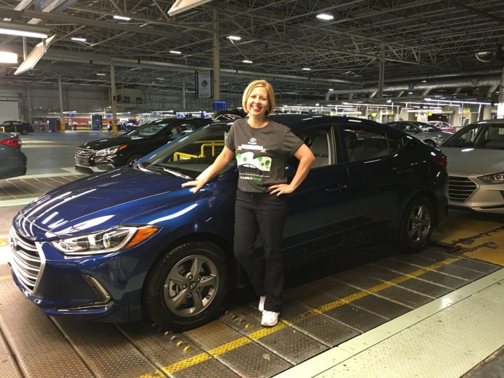 Kim with Hyundai Elantra Eco on Manufacturing Assembly Line