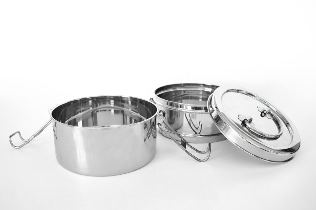 stainless steel tiffin lunchbox containers on white background
