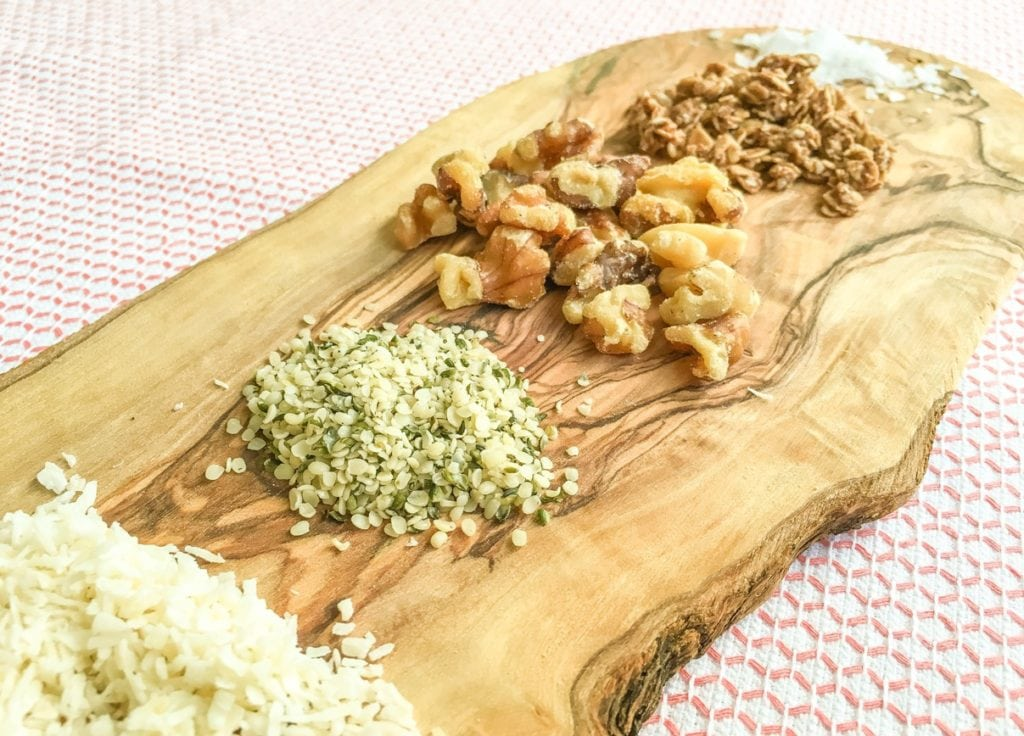 wooden serving tray with hemp seeds walnuts and granola