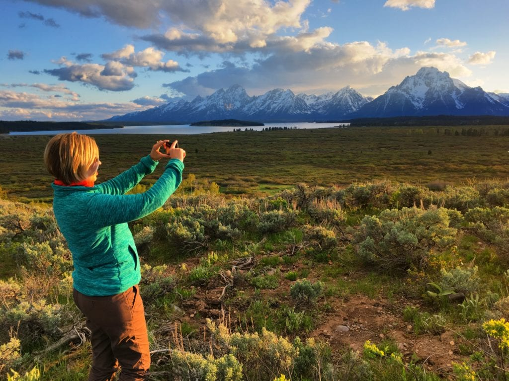Kim photographing the Grand Tetons with iPhone