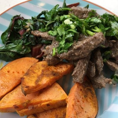 sweet potatoes kale and meat on a plate