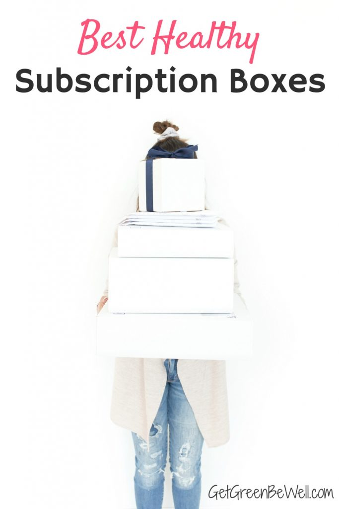 woman holding white boxes in front of her