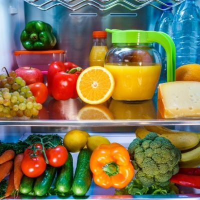 refrigerator shelves stocked with fresh fruits and vegetables