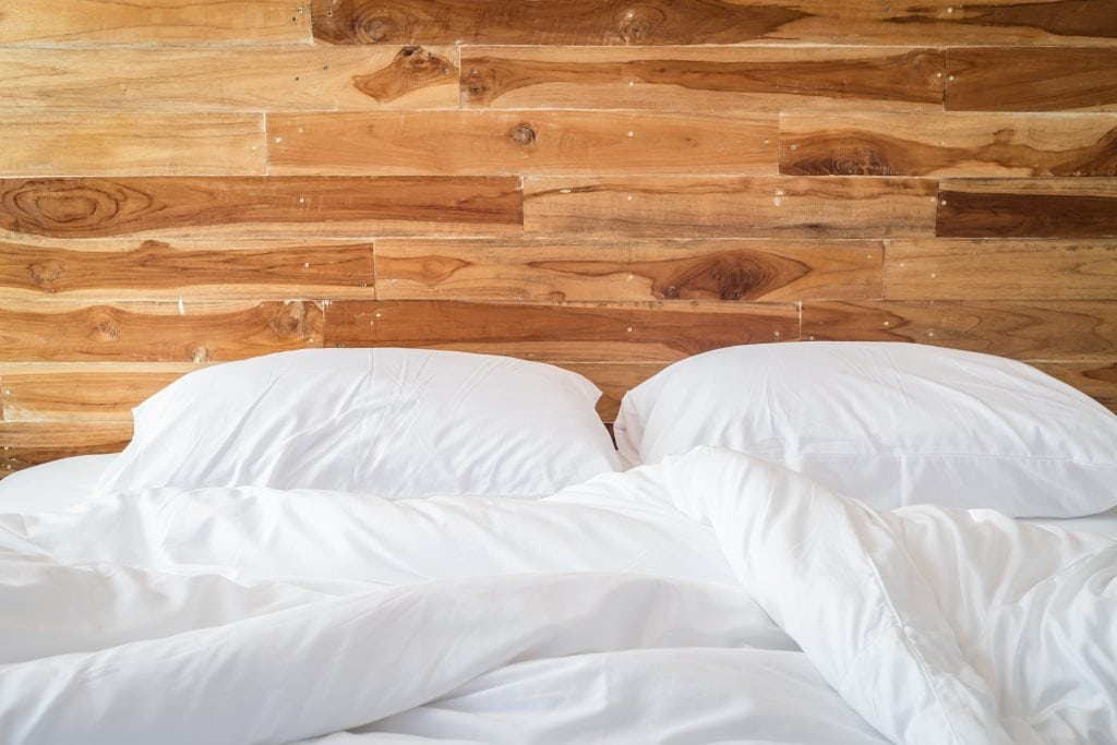 How to afford a non-toxic bed. An organic mattress can be expensive. Here are brilliant ways to reduce the cost of a healthy bedding and get a good night's sleep and cut down on your family's exposure to chemicals.