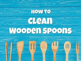 blue wooden background with wooden spoons and wood spatulas