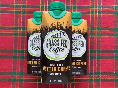 grass fed coffee single serve bottles against plaid background