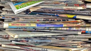 stack of newspapers to be used as mulch in the garden
