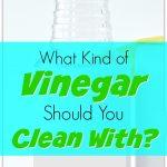 clear glass bottle of vinegar on white background
