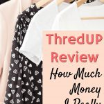 thredup reviewwhite black and pink women's clothing hangin on wooden hangers in closet
