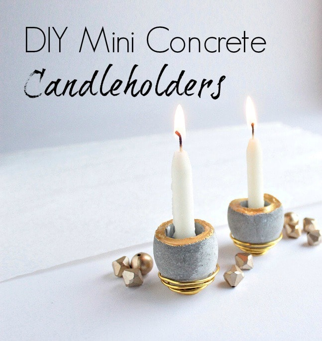 grey and gold Concrete candlholders with candles that are lit up