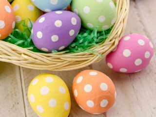 polka dot eggs in an Easter basket with grass