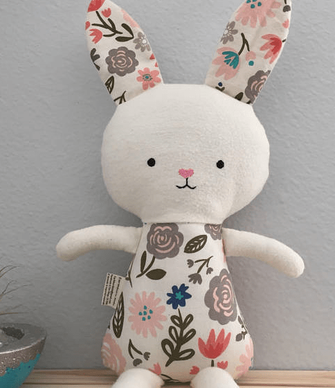 stuffed handmade Easter bunny rabbit with floral fabric and white face