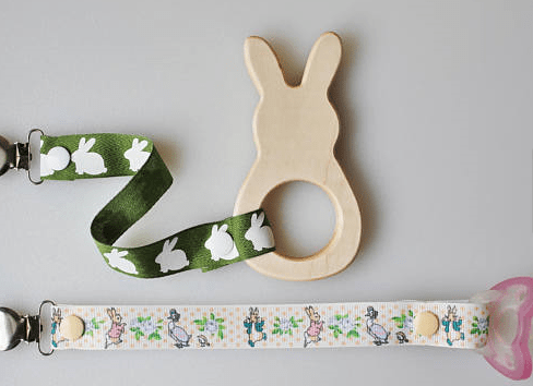 wood bunny baby teether with easter ribbon attached to pacifier