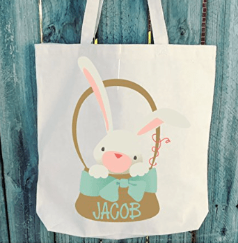 canvas tote bag with a bunny in an easter basket and child's name