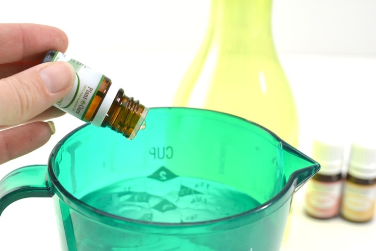 Drops of essential oil added to homemade vinegar cleaner