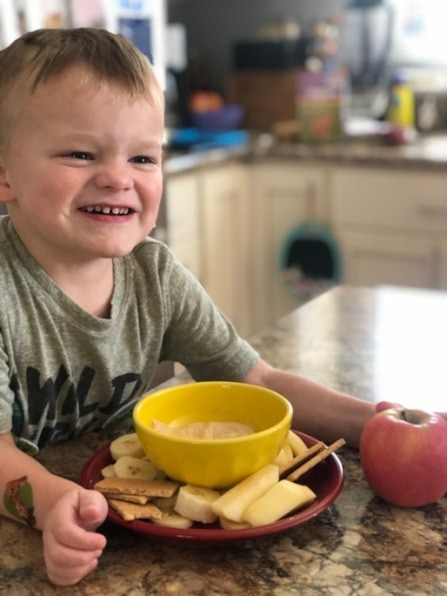 child smiling with snacks