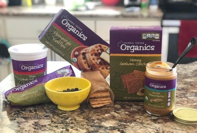 yogurt waffles graham crackrs peanut butter chocolate chips on kitchen countertop