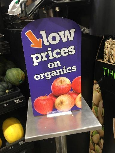 purple sign with red apples