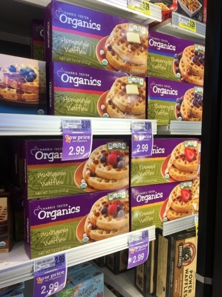 boxes of frozen waffles in a freezer with price tags