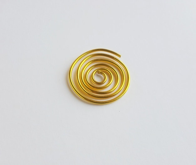 gold metal wire rolled up into a circle