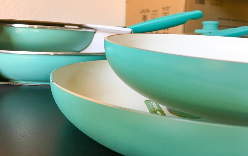 turquoise nonstick pans with white ceramic interior coatings