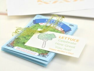 packs of lettuce seeds tied together with a ribbon and a printable gift tag for mothers day garden gift
