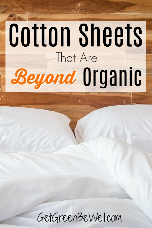 organic cotton sheets on bed with two pillows against wooden headboard