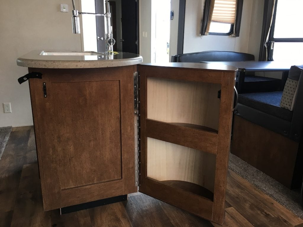 kitchen island storage shelves in an RV