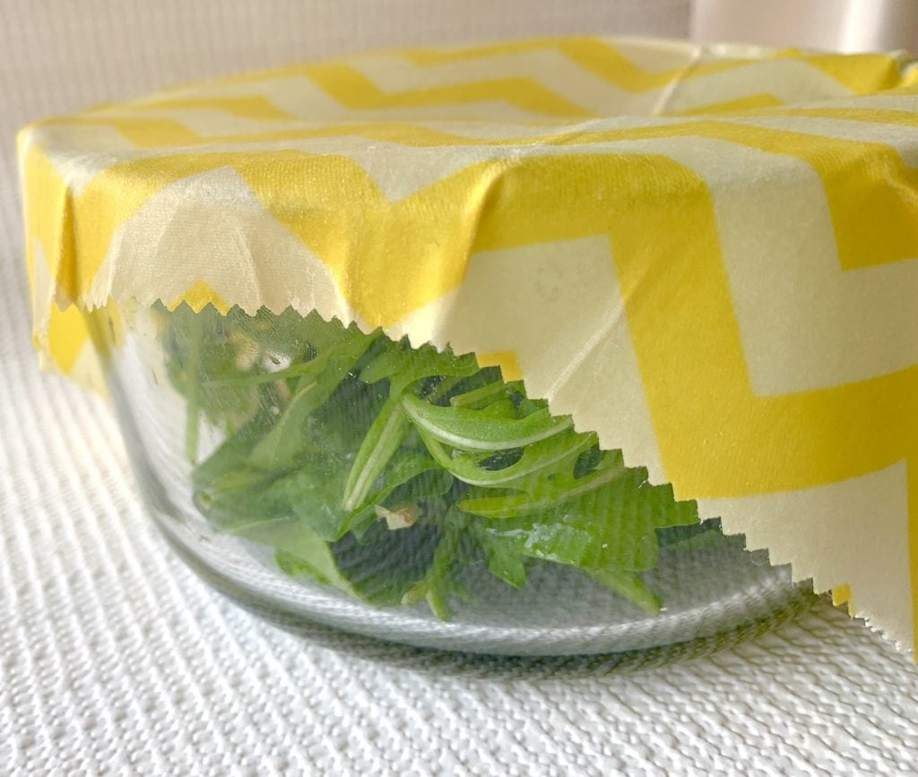 beeswax wrap on glass bowl with salad