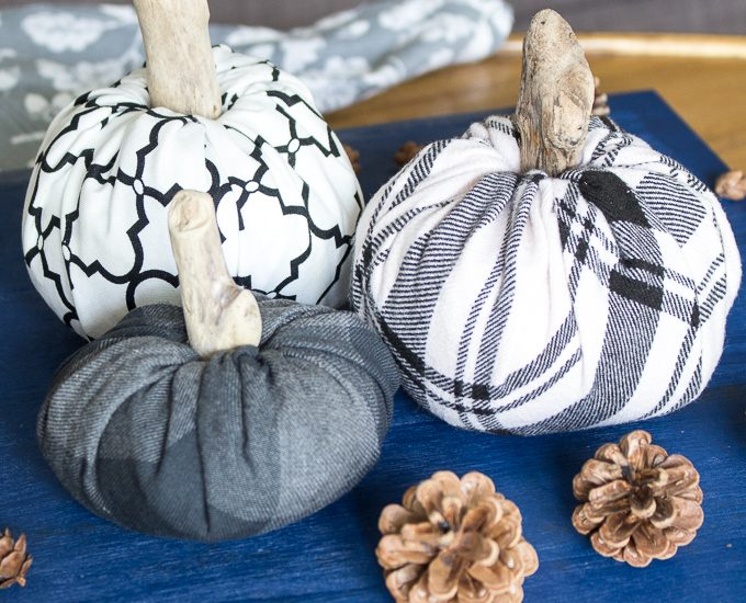 fabric pumpkins against blue background