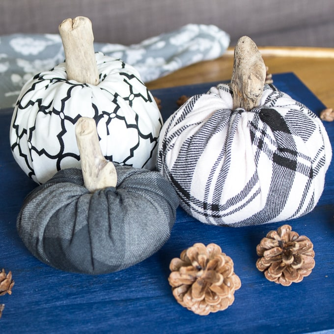 fabric pumpkins against blue background