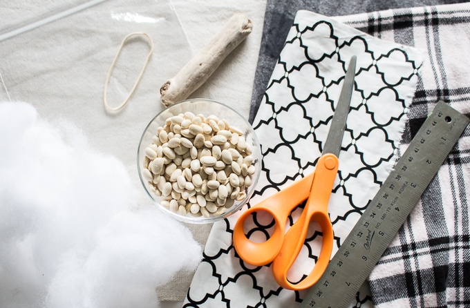 scissors and a bowl of dried beans on white and black geometric fabric scrap