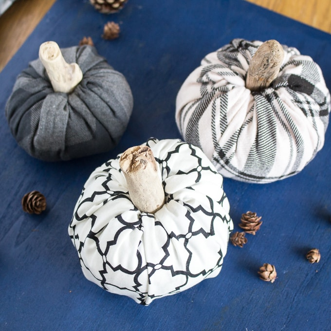DIY No Sew Fabric Pumpkins on blue background