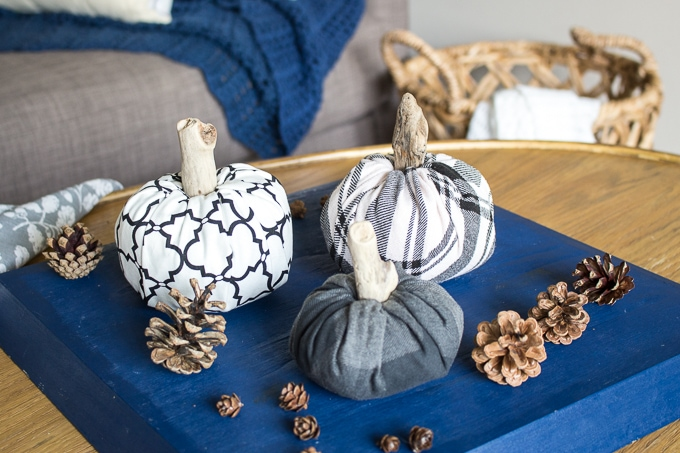 DIY No Sew Fabric Pumpkins on wood table with pinecones