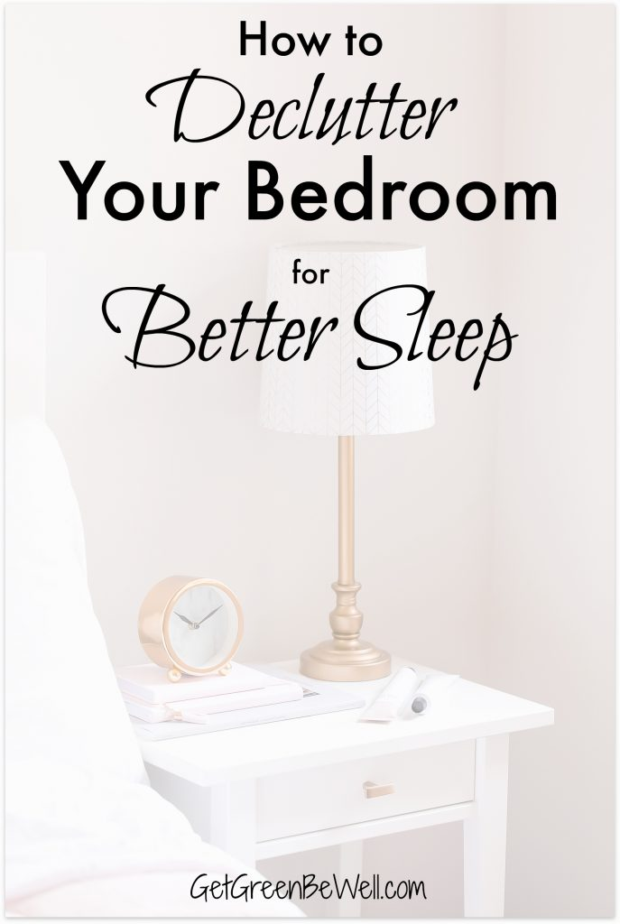 Bedside lamp on night table in bedroom with clock and books on top