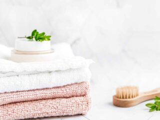 white and pink hand towels in bathroom