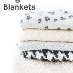 stack of warm fuzzy weighted blankets in grey, white and cream colors