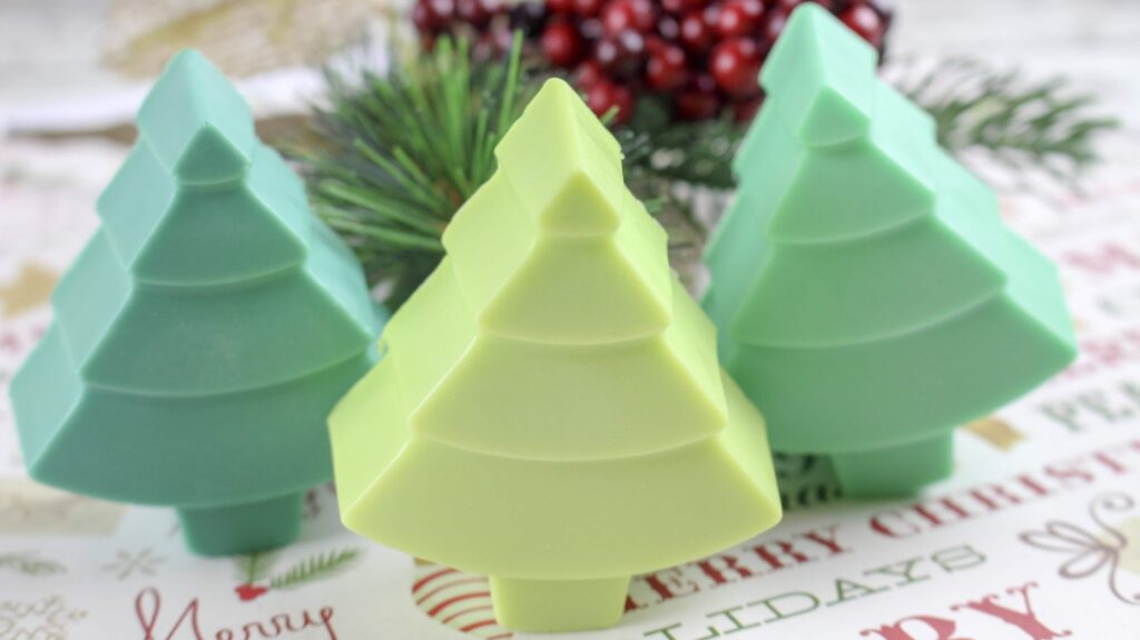 three Christmas tree soaps in different shades of green