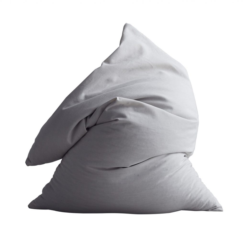 Pillow crumpled up against white background