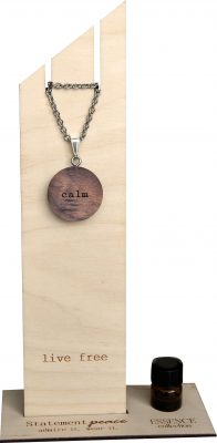 wooden circle necklace with word calm and small bottle of essential oil