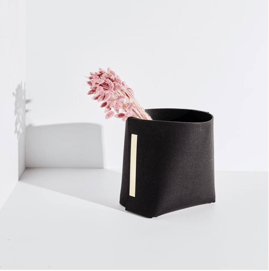 recycled rubber basket with pink flower stem