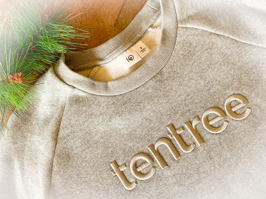 tentree grey sweatshirt on cork background review sustainable fashion clothing