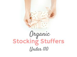 organic stocking stuffers woman holding gift with polka dot gift wrap and pink ribbon