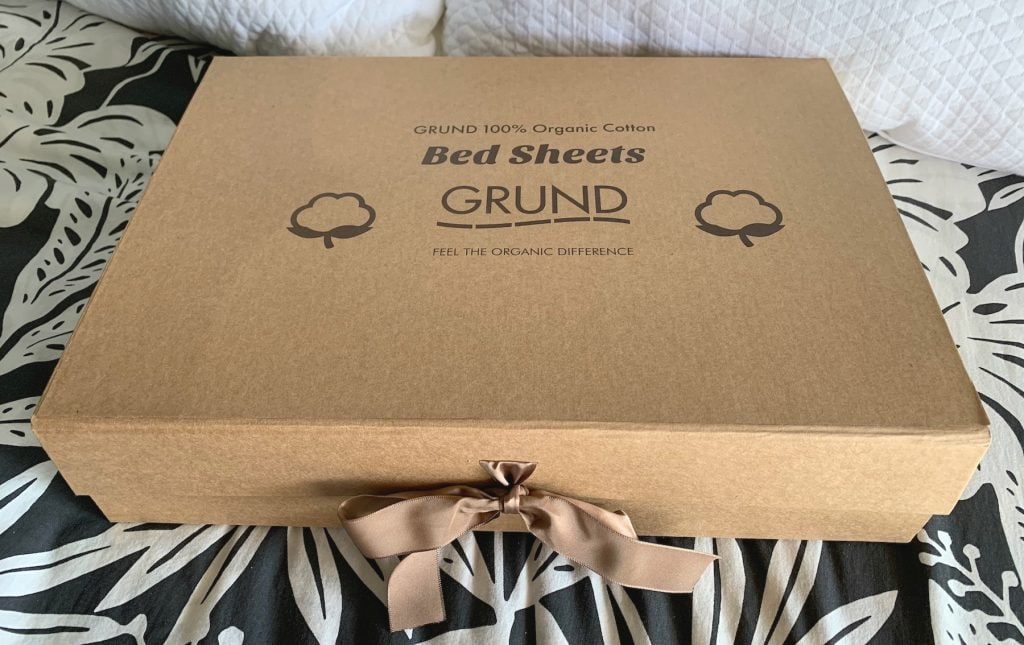 grund America organic cotton bed sheets box tied with brown ribbon bow